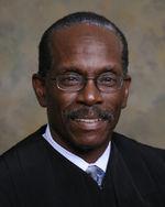 Hon. J. Cedric Simpson's Profile Image